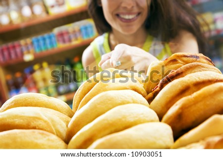 customer in a supermarket buying a slice of pizza - stock photo