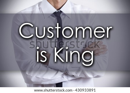 Customer is King - Closeup of a young businessman with text - business concept - horizontal image