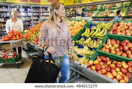 Customer Looking At Fresh Fruits In Grocery Shop