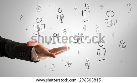 Customer managed relationship concept with a male hand presenting random people icons. - stock photo