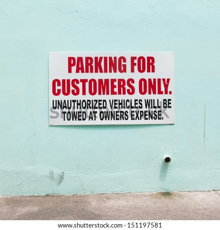 Customer parking only sign on a blue wall - stock photo