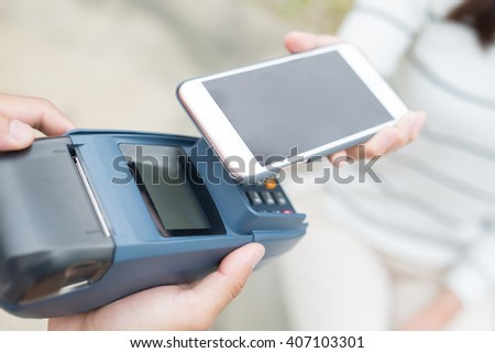 Customer pay by cellphone, great for your design - stock photo
