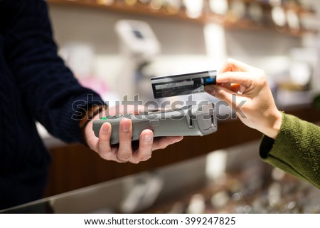 Customer pay by NFC at shop - stock photo
