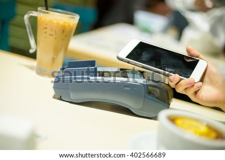 Customer pay on cellphone at restaurant - stock photo