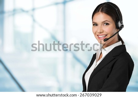 Customer. Picture of friendly female helpline operator with headphones - stock photo