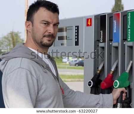 Customer Refilling Car at Gas Station - stock photo