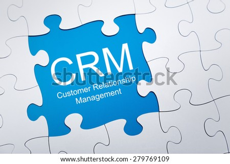 Customer relationship management on puzzle - stock photo