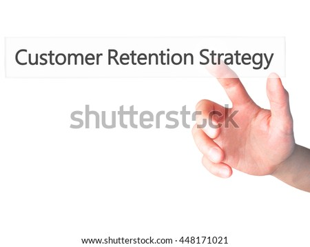 Customer Retention Strategy - Hand pressing a button on blurred background concept . Business, technology, internet concept. Stock Photo