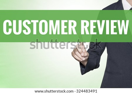 Customer Review word on green virtual screen touching by business woman - stock photo