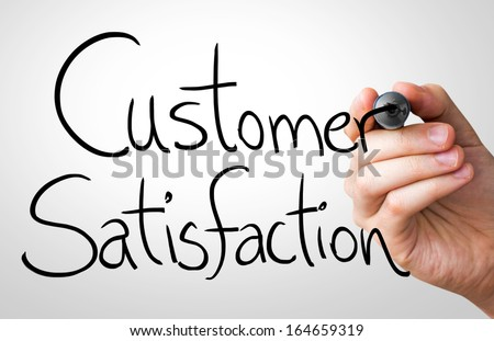 Customer Satisfaction hand writing with a black mark on a transparent board - stock photo