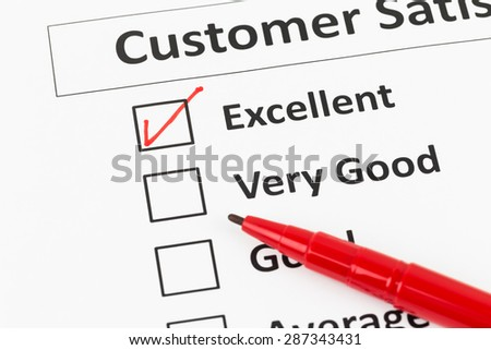 Customer satisfaction survey checkbox and pen with excellent tick - stock photo
