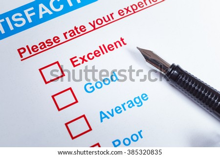 Customer satisfaction survey checkbox with rating and pen, can use any business concept - stock photo