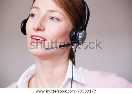 Customer Service Agent - Portrait of pretty business woman with headset - stock photo