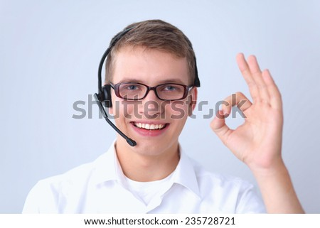 Customer service agent showing ok, isolated on white background - stock photo