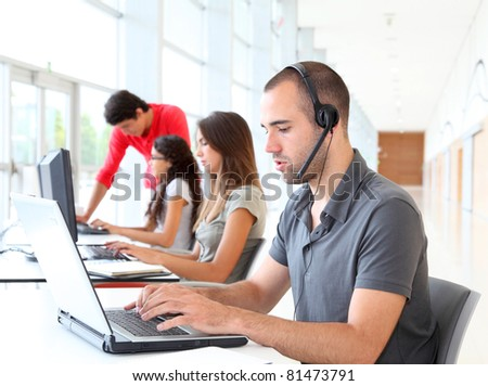 Customer service employee with headphones on - stock photo