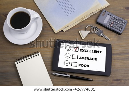 Customer service evaluation concept . Text on tablet device on a wooden table - stock photo