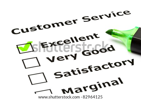 Customer service evaluation form with green tick on Excellent with felt tip pen. - stock photo