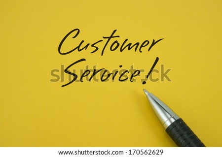 Customer Service! note with pen on yellow background