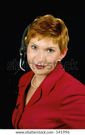 Customer service operator with headset and pearl necklace. - stock photo