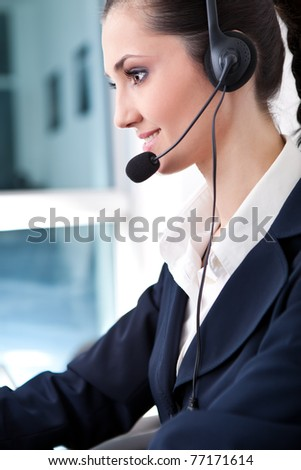 customer service operator woman with headset smiling, side view - stock photo