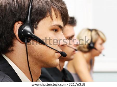 Customer service operators at work - stock photo