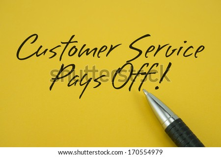 Customer Service Pays Off! note with pen on yellow background