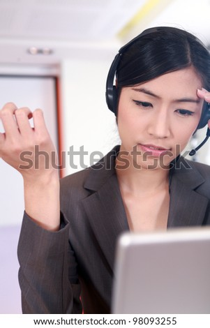customer service representative at the office with computer - stock photo