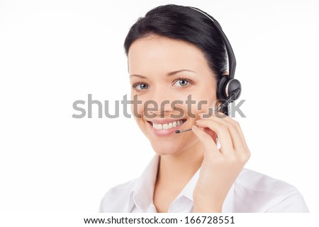 Customer service representative. Beautiful young woman in headset smiling and looking at camera while isolated on white - stock photo