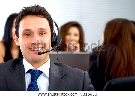 customer service representative man - smiling in his office - stock photo