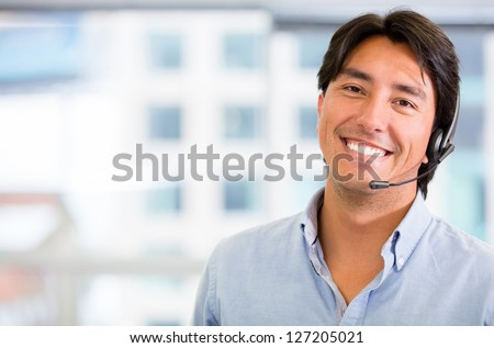 Customer service representative wearing a headset at the office - stock photo