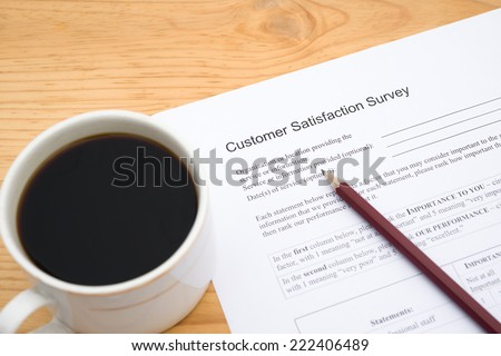 customer service satisfaction survey form and cup of coffee - stock photo