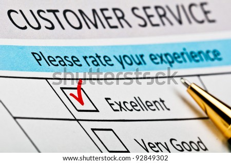 Customer service satisfaction survey form with red tick placed in excellent checkbox. - stock photo