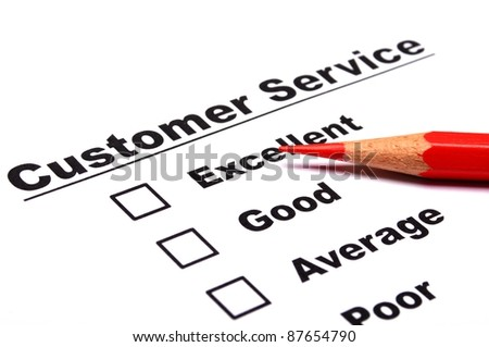 customer service survey with checkbox on form an red pencil - stock photo