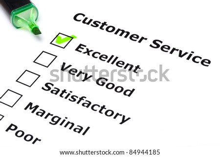 Customer service survey with green tick on Excellent with felt tip pen. - stock photo