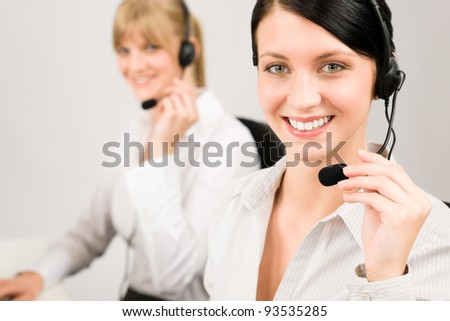 Customer service team woman call center smiling operator phone headset - stock photo