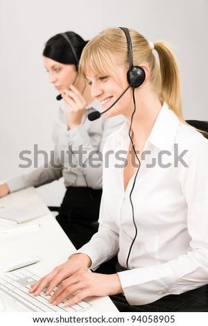 Customer service team woman call center smiling operator phone headset - stock photo