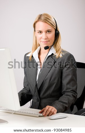Customer service woman call operator phone headset working on computer