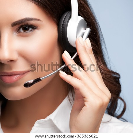 customer support female phone worker, against grey background. Consulting and assistance service call center. - stock photo