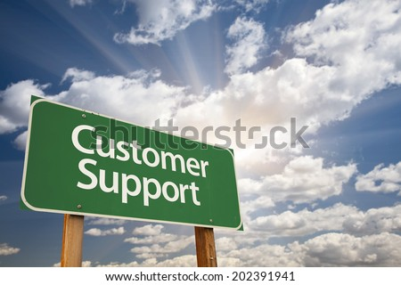 Customer Support Green Road Sign with Dramatic Clouds and Sky. - stock photo