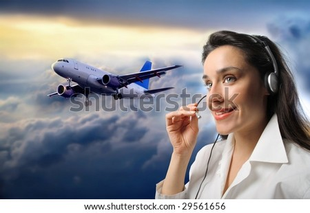 customer support operator against a cloudy sky with airplane - stock photo