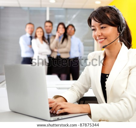Customer support operator at a call center - stock photo