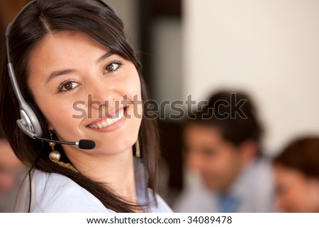 customer support operator smiling in an office - stock photo