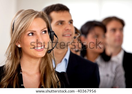 Customer support operator team at an office - stock photo