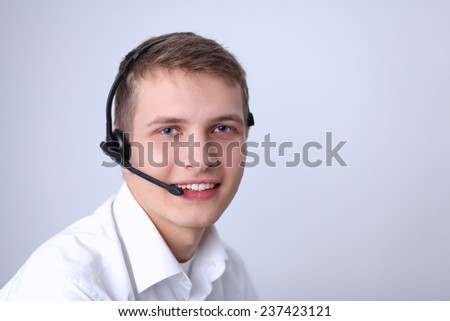 Customer support operator with a headset isolated on white background - stock photo