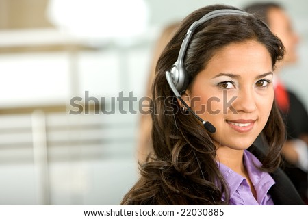 customer support operator woman in an office - stock photo