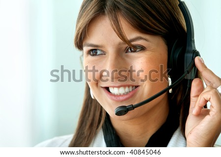 customer support operator woman smiling - isolated over white - stock photo