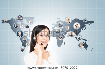 Customer support operator working in a call center office. Global business concept. World map with a businesspeople talking to phone.