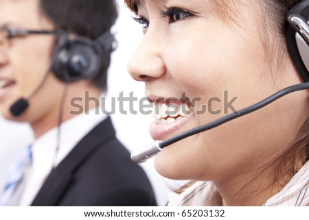 customer support team with  smiling businesswoman in an office - stock photo