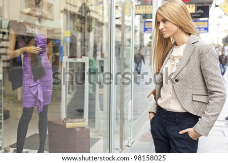 Customer woman in shoping street, looking at window, outdoor - stock photo