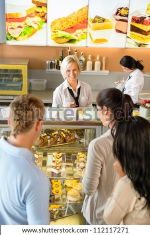 Customers waiting in line to buy dessert woman man cafe - stock photo